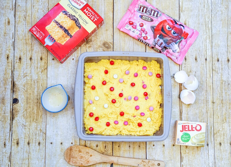 Baked cookie bars inside square baking dish.