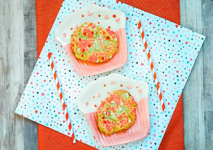 These Valentine's Day sprinkle cookies are easy to make and fun to eat!These yellow cake mix cookies are rolled in Valentine themed sprinkles, making them the perfect Valentine's Day treat!