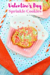 "A pink and white plate with a sprinkle cookie on it and the words ""valeintine's day sprinkle cookies"" in pink."