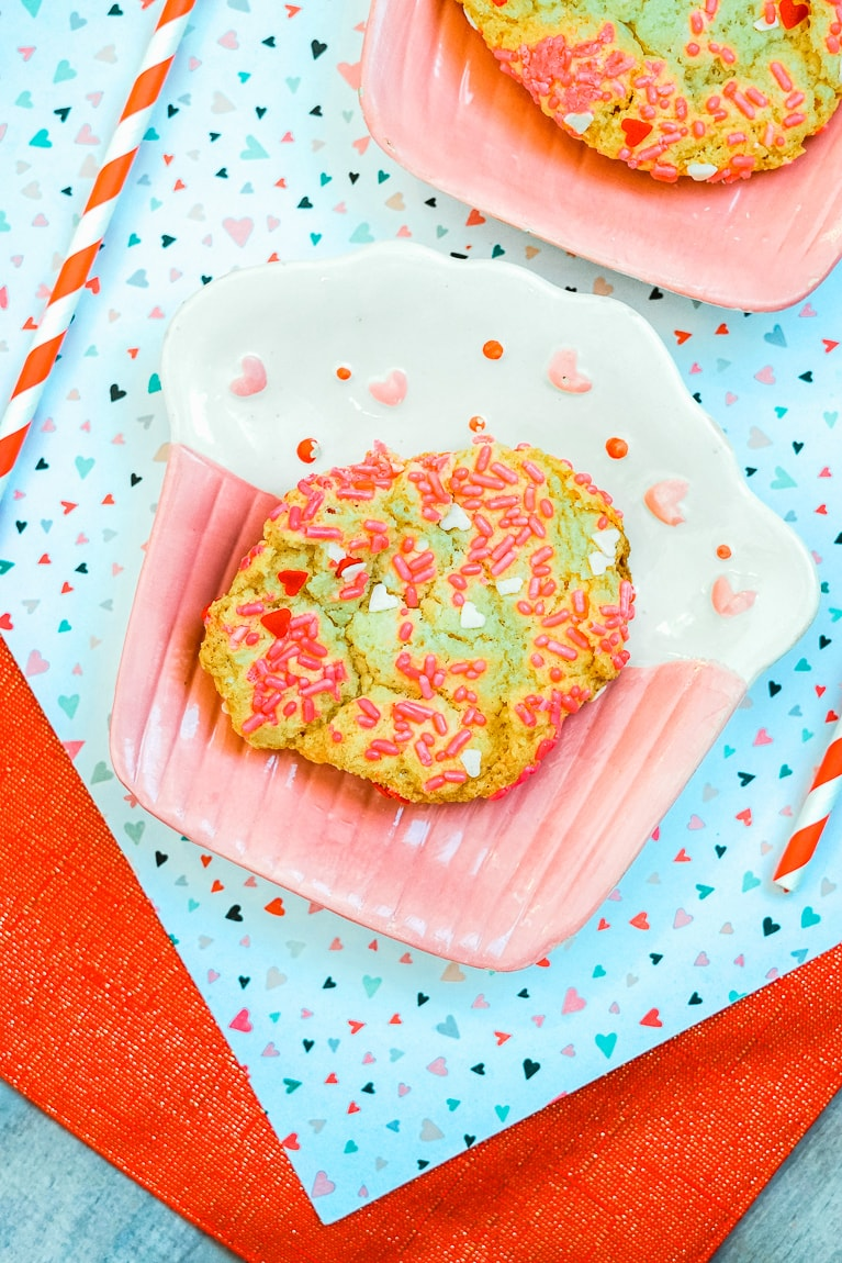 Close up of sprinkle Valentine's Day cookie.
