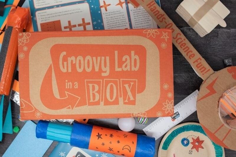 Groovy Lab Box with STEAM crafts around it.