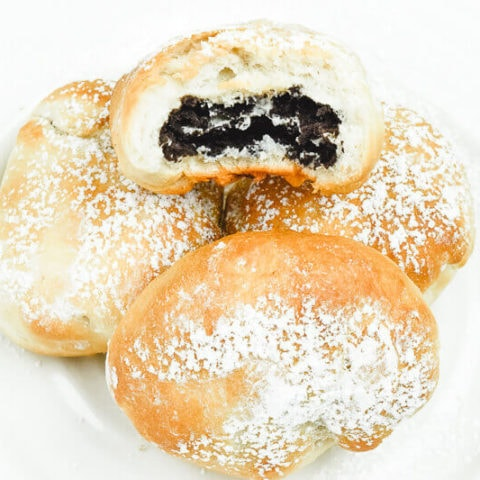 Close up for air fried Oreos dusted with powdered sugar.