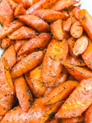 Close up of air fried carrots covered in herbs.
