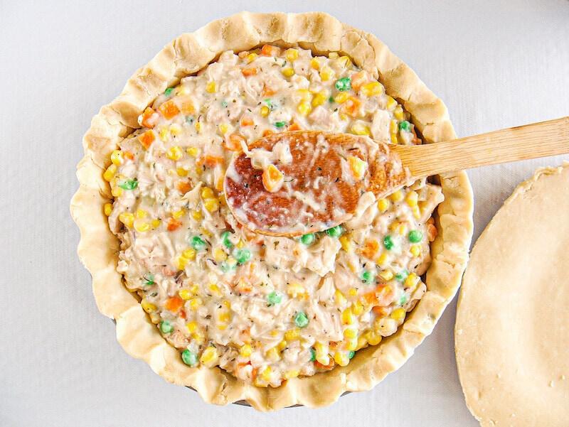 Chicken pot pie filling inside of pie crust.