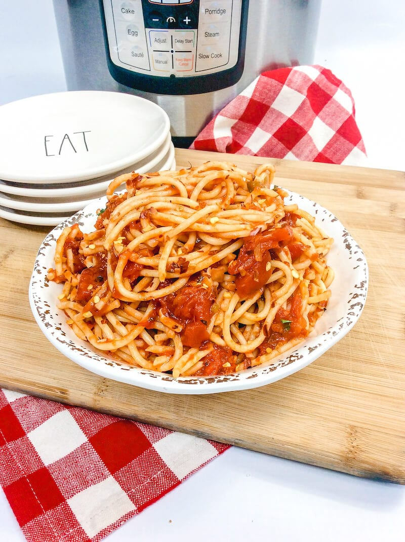 Side view of plate piled high with spaghetti.