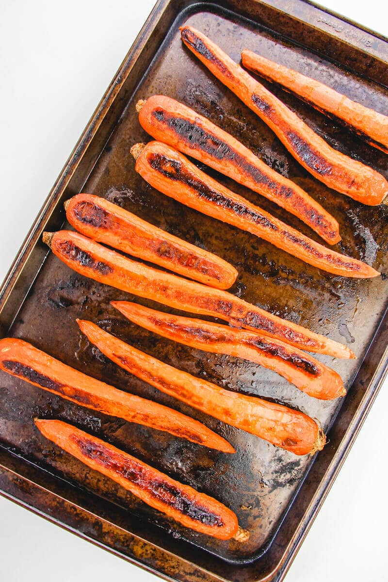 Roasted carrots on a cookie sheet.