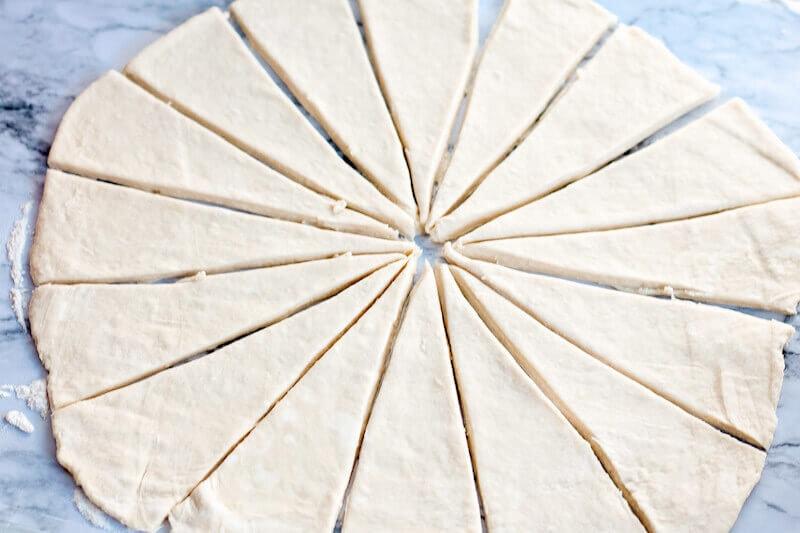 Crescent roll dough cut into triangles.