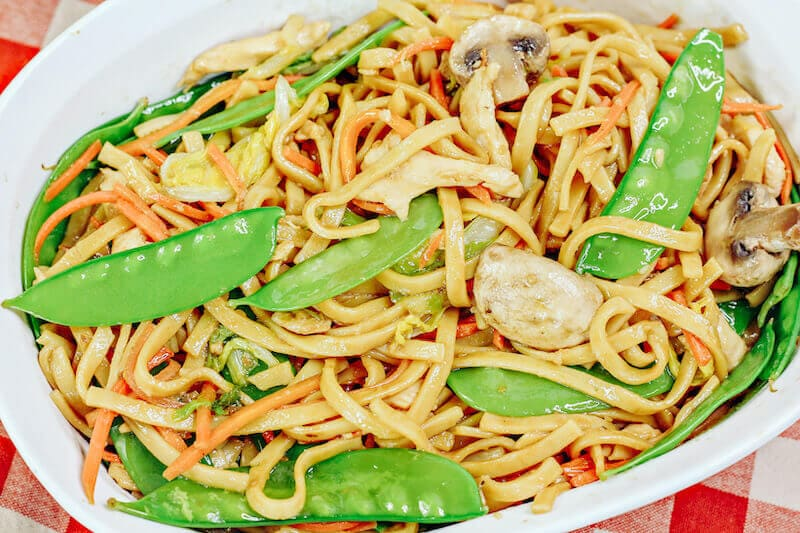 Overhead shot of lo mein in a white dish.