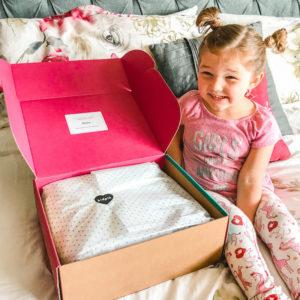 A little girl ready to open her KidPik Box.