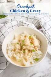 "A white bowl of rice topped with chicken and gravy with the words ""crockpot chicken & gravy"" in blue letters."