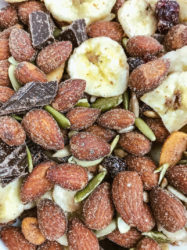 Close up of spicy trail mix with banana chips and dark chocolate.