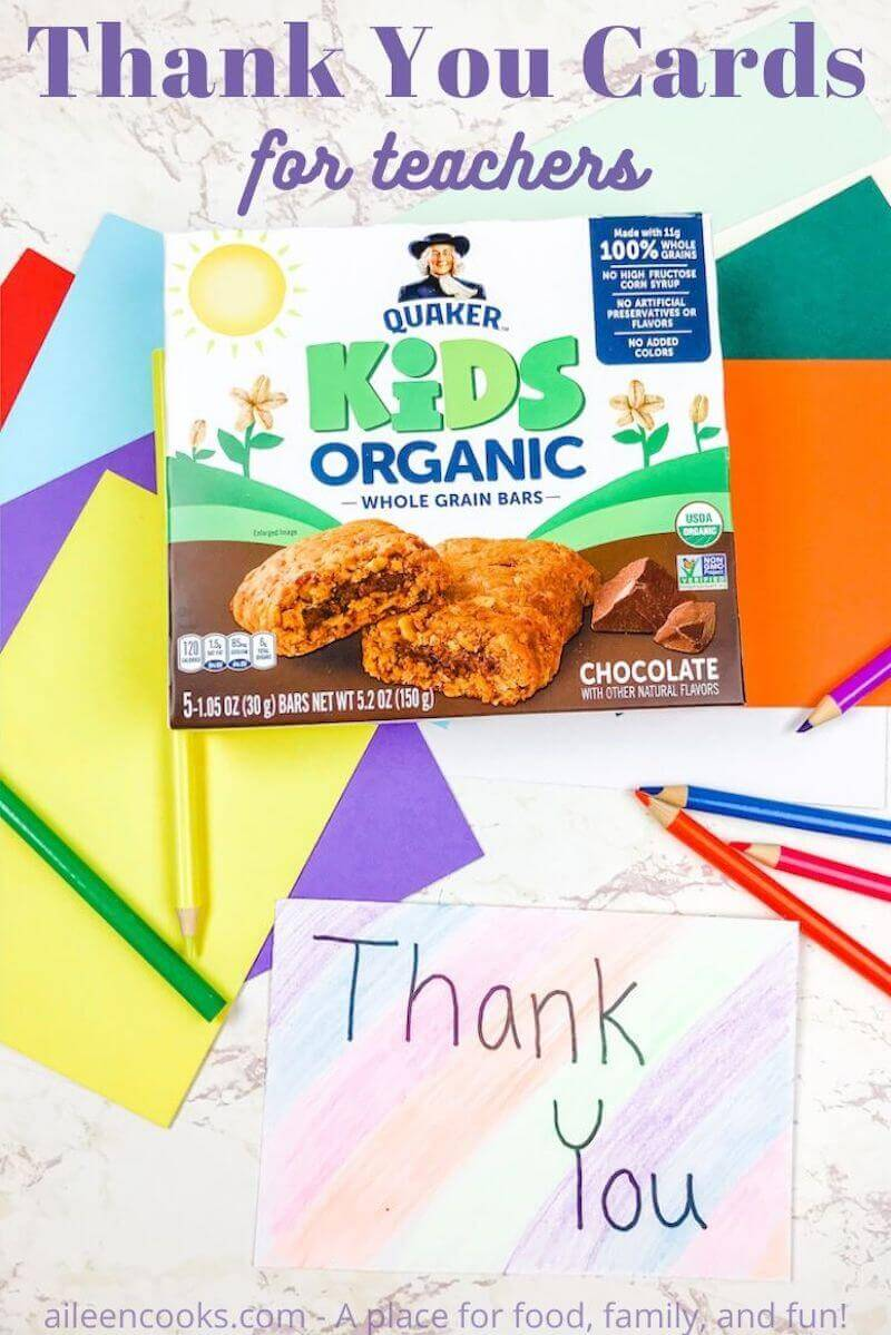 A box of Quaker Kids Organic Bars on top of colorful envelopes and next to a hand colored card that says Thank You.