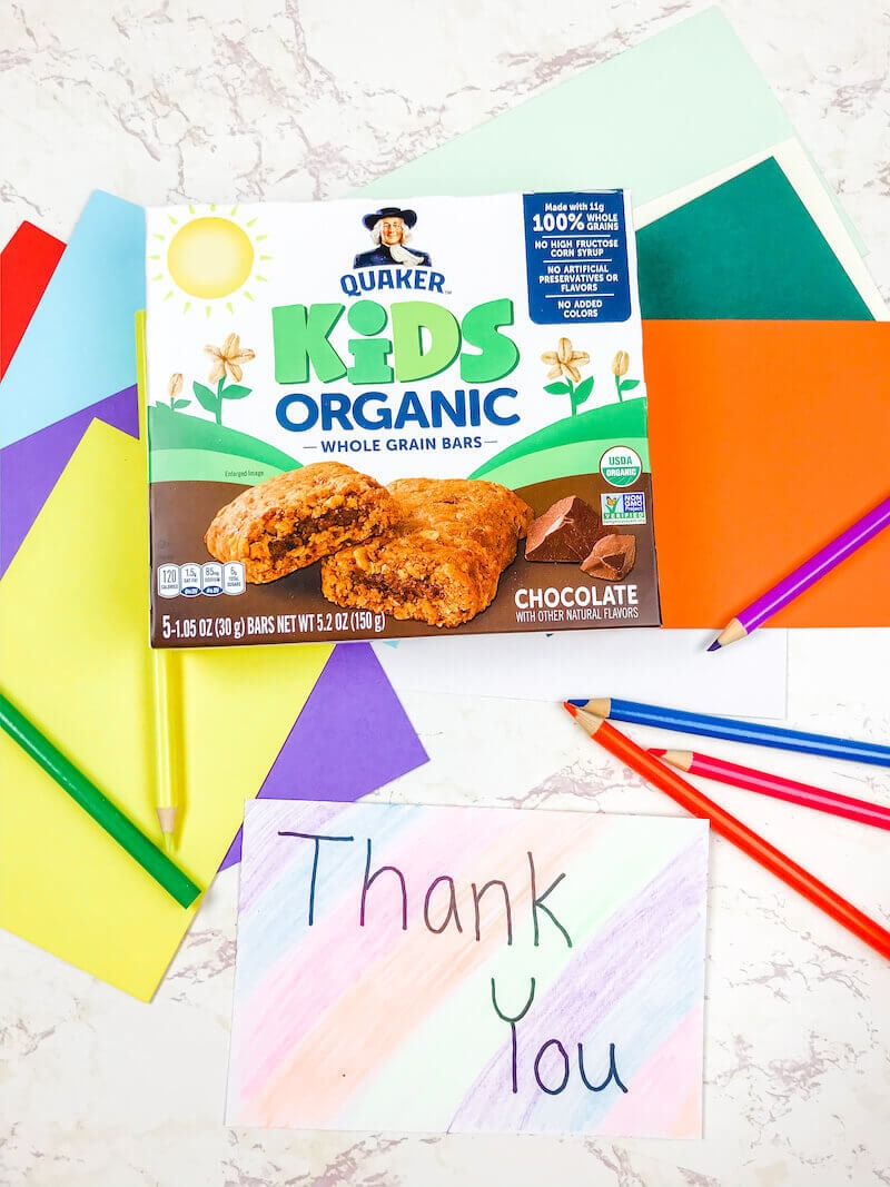 A box of Quaker Kids Organic Bars above a colorful handmade thank you card.