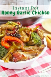 """A white bowl piled high with honey garlic chicken with the words """"instant pot honey garlic chicken"""" in green lettering."""