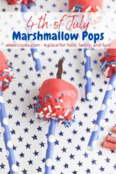 "A close up of a marshmallow pop with the words ""4th of July marshmallow pops"" in red and blue lettering."