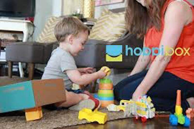 A mother and child playing with stacking blocks.