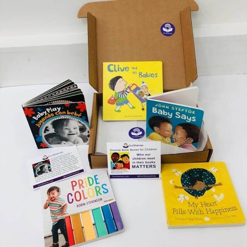 A box holding 5 diverse books featuring chidden of color.