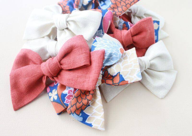 A pile of pink and floral baby bows.