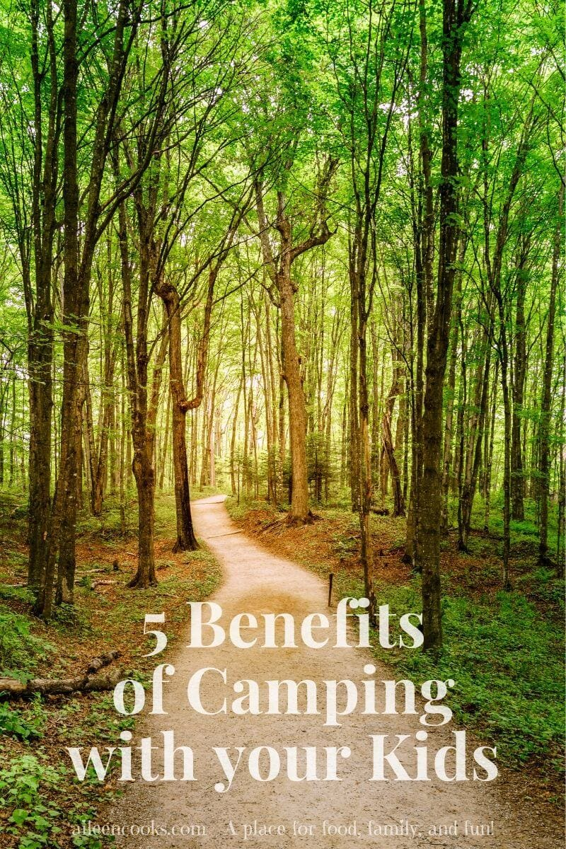 "A trail in a forest with the words ""5 benefits of camping with your kids"""
