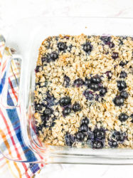 Partial view of a glass baking dish filled with blueberry baked oatmeal.