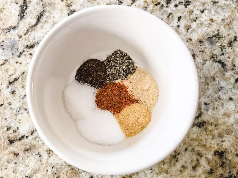 Seven seasonings in a white bowl.