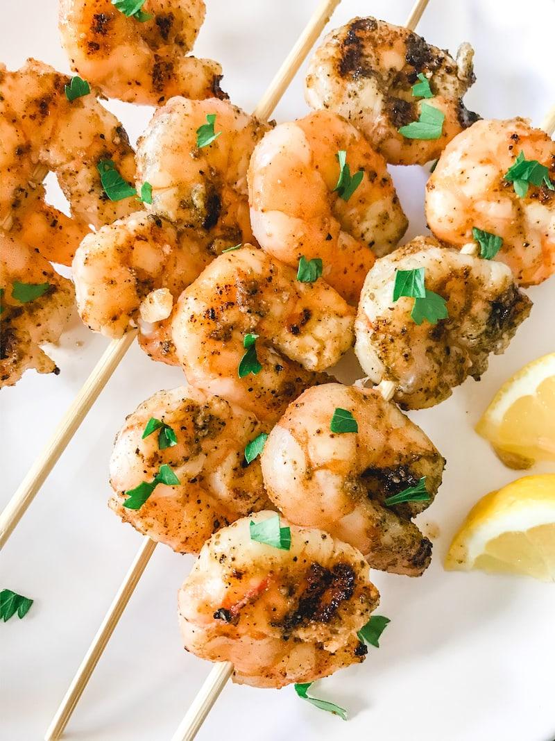 Close up of grilled shrimp on skewers.