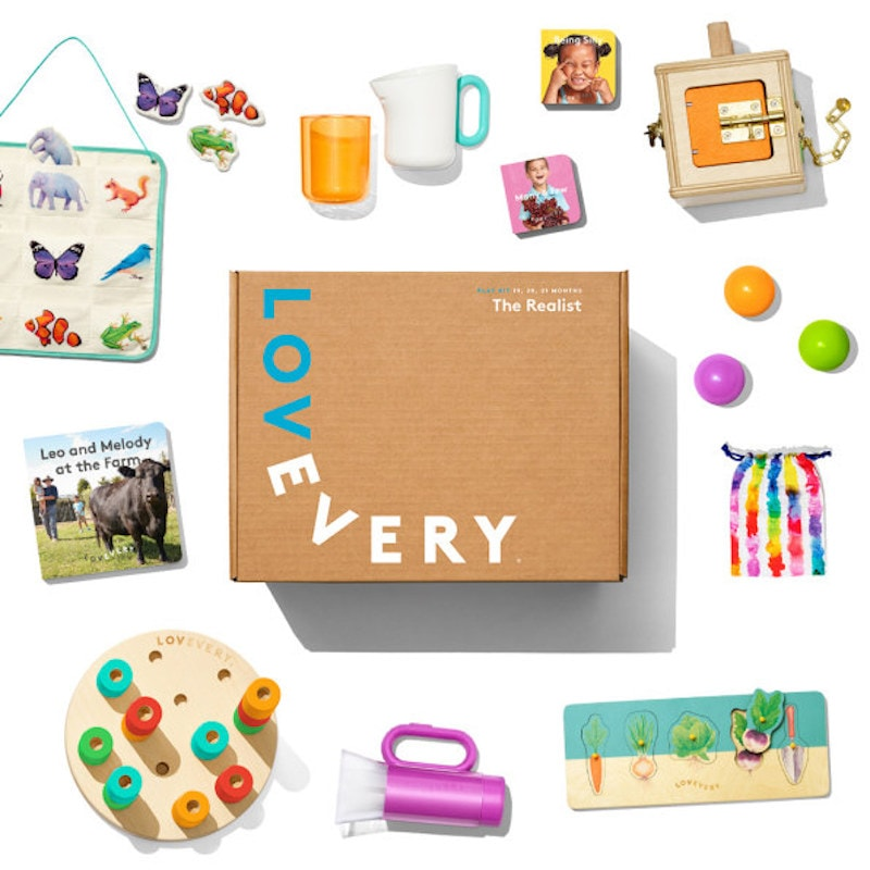 "A box that says ""LovEvery"" surrounded by baby toys."