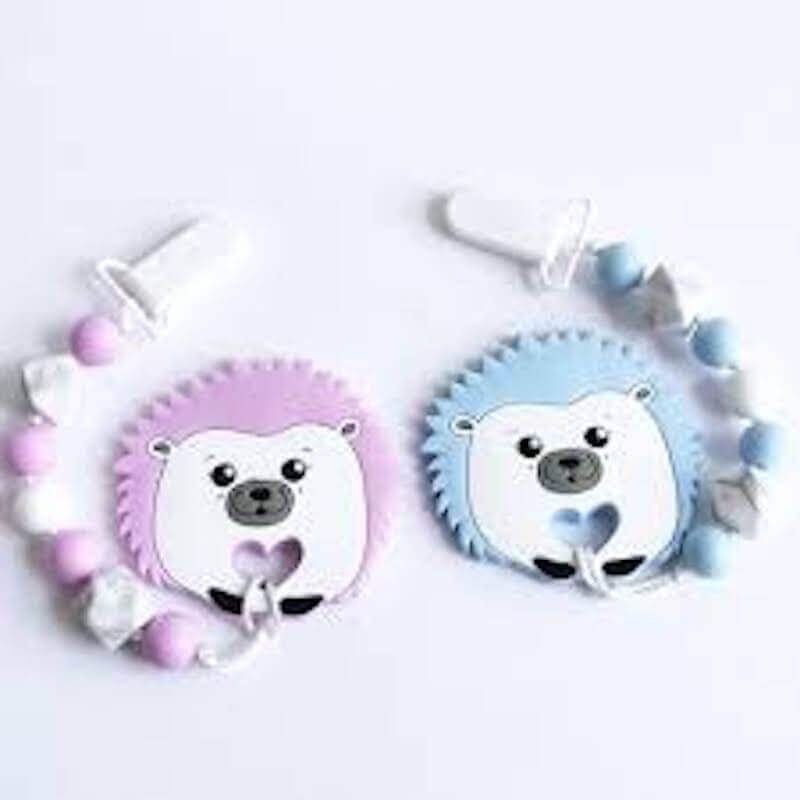 Two baby chewlery toys, one pink and one blue.