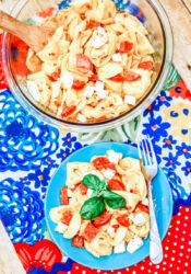 Overhead shot of pasta salad on a plat and pasta salad in a bowl.