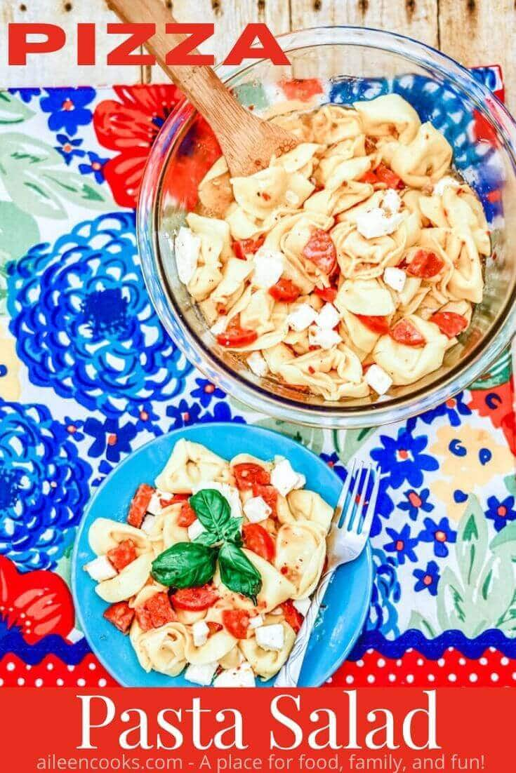 "A bowl and plate of pasta salad with the words ""pizza pasta salad"" in red letters."