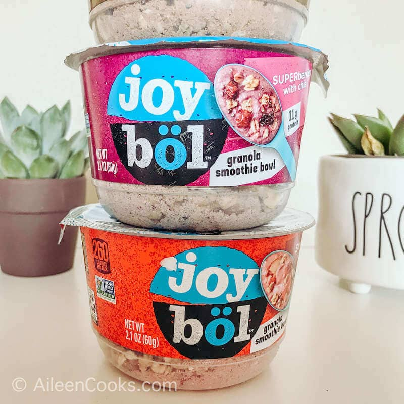 Two Joybol smoothie bowls stacked on top of each other.