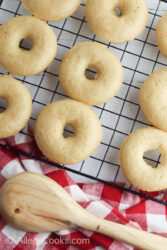 Baked apple cider donuts on a cooling rack.