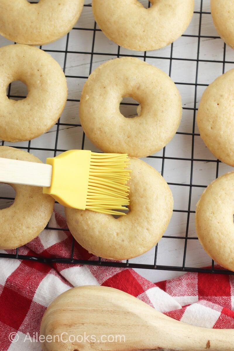 Melted butter brushed apple cider donuts.