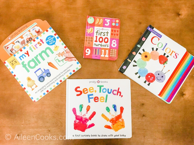 Four children's board books laid out on a coffee table.
