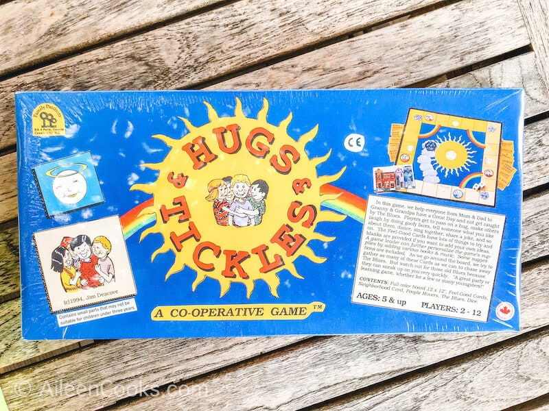 "A blue board game with the words ""hugs & tickles"""