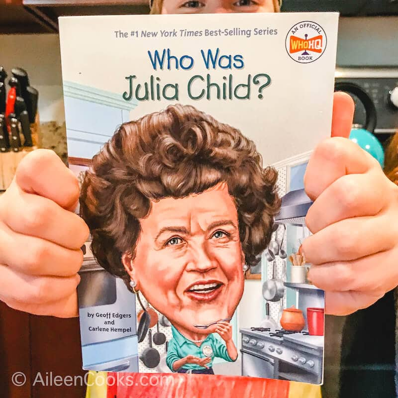 Two hands holding up The Who Was Julia Child? book.
