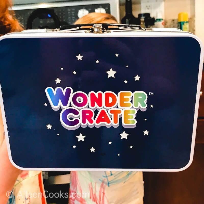 The front of the Wonder Crate tin lunch box.