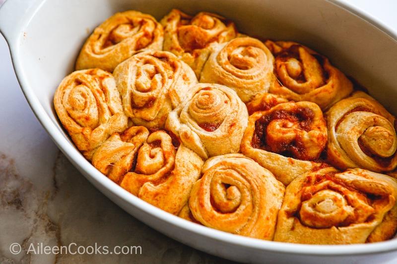Pumpkin cinnamon rolls in a baking dish