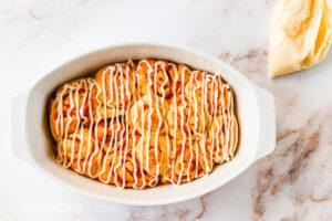 Drizzle Pumpkin cinnamon rolls frosting