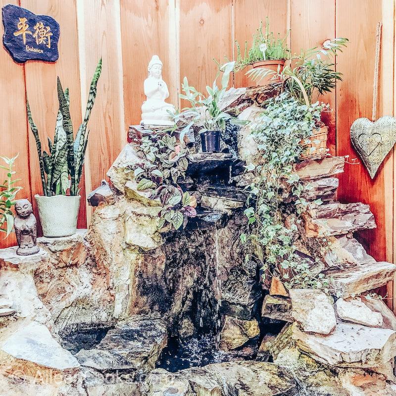 A fountain and buddha statue.