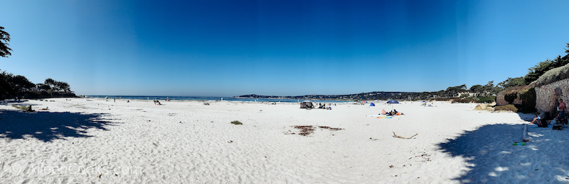 A view of the white sand beach and Pacific Ocean in Carmel by the Sea.