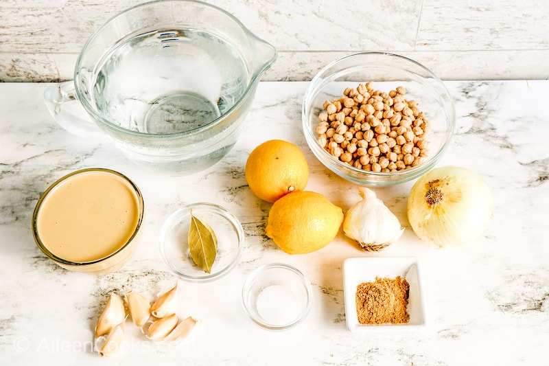 Ingredients for hummus on a white counter.