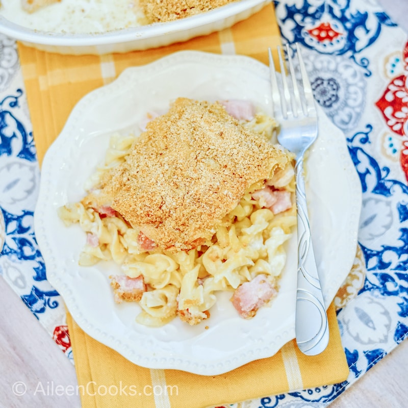 A white plate filled with chicken cordon bleu casserole.