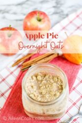 """A jar of overnight oats with the words """"apple pie overnight oats"""" in red lettering."""