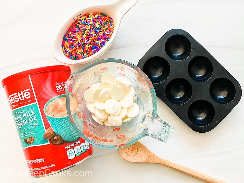 The ingredients for white chocolate hot cocoa bombs.