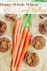 """Carrot muffins surrounding a bunch of carrots with the words """"honey whole wheat carrot muffins"""" in brown and orange lettering."""