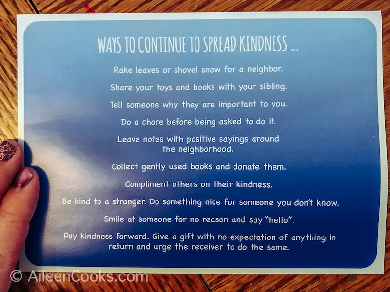 A blue paper with ideas for spreading kindness.
