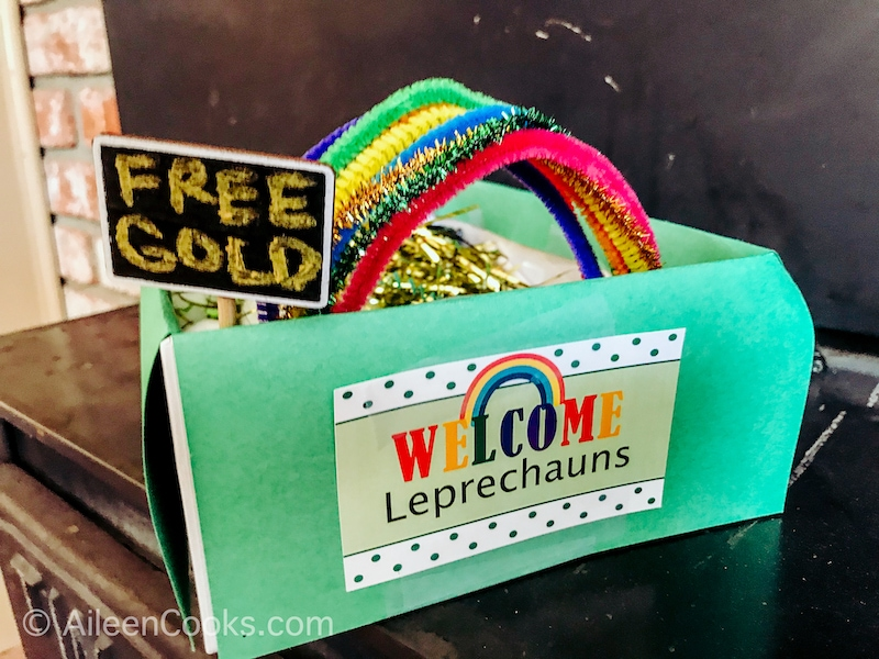 "A leprechaun trap with a sign that says ""free gold"" poking out of the top."