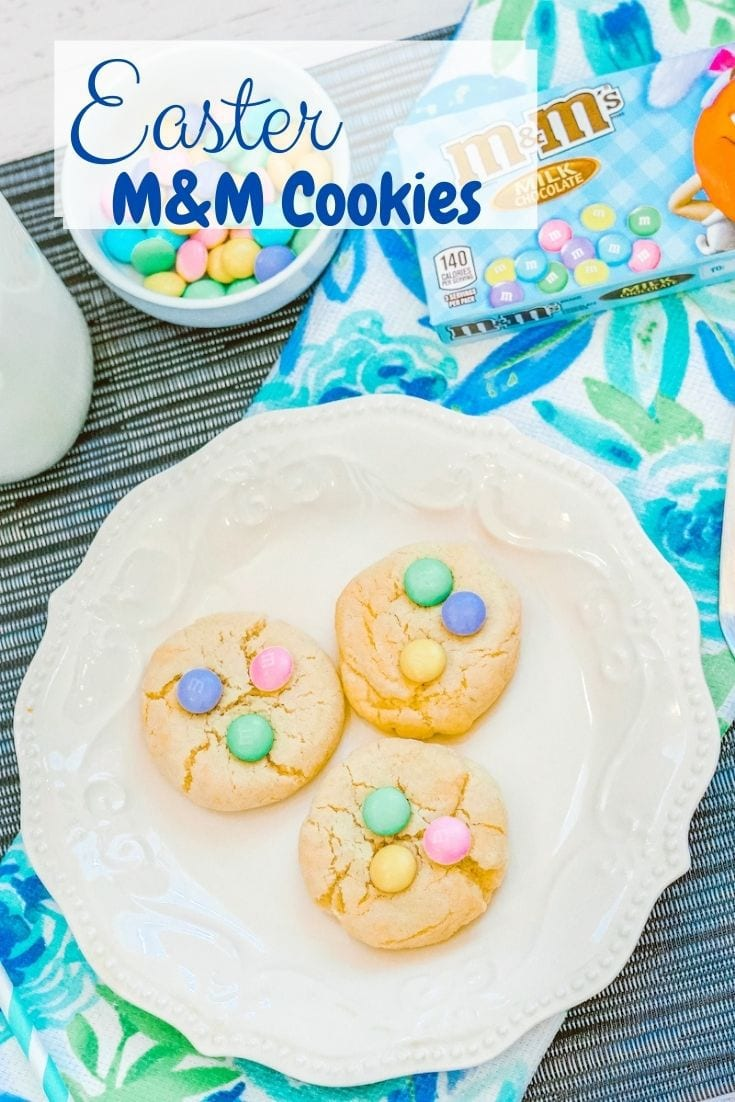 "A white plate with three Easter cookies on it and the words ""Easter M&M Cookies"" In blue lettering."
