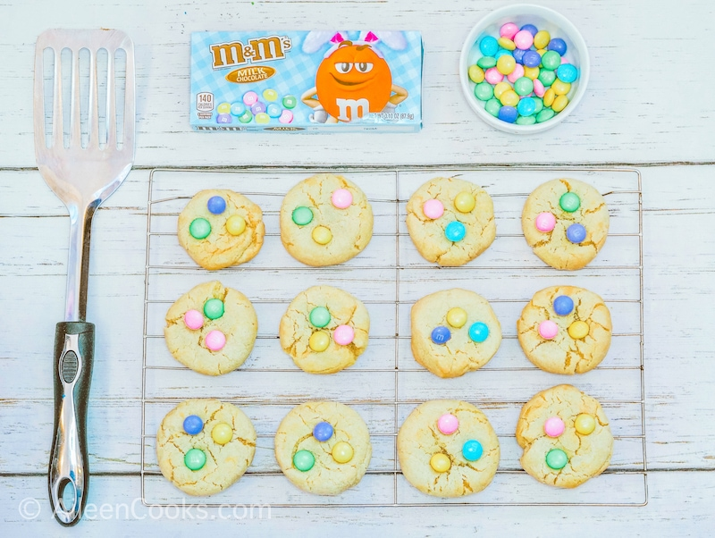 M&M Cookies cooling on a metal rack.